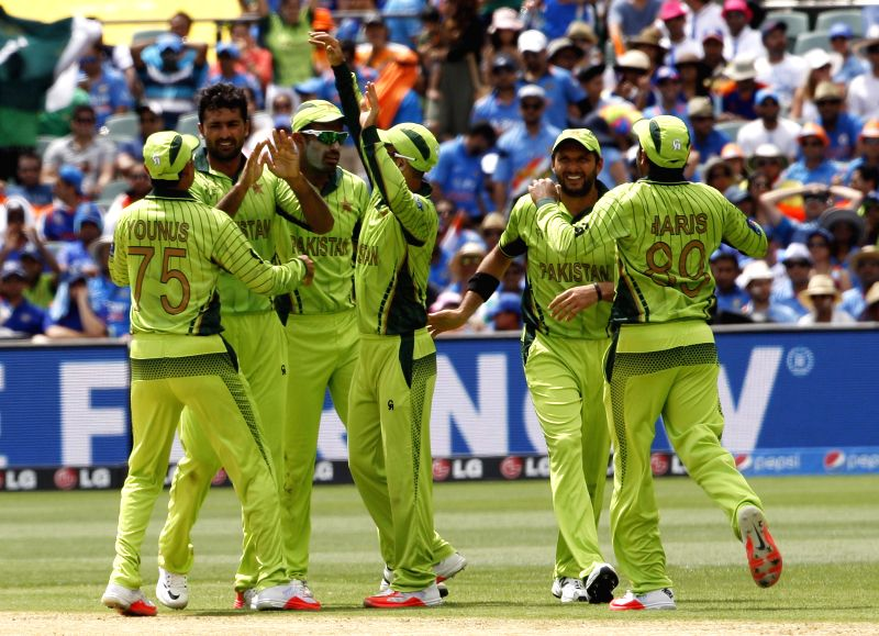 Pakistani players celebrate fall of wicket during the cricket World Cup match between India and Pakistan at Adelaide on Feb. 15, 2015.