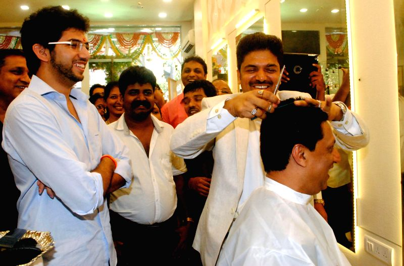 Aditya Thackeray,Shivarama Bhandary and Madhur Bhandarkar during the opened Shivarama K Bhandary`s sixth hair design saloon in Mumbai on June 30, 2014.