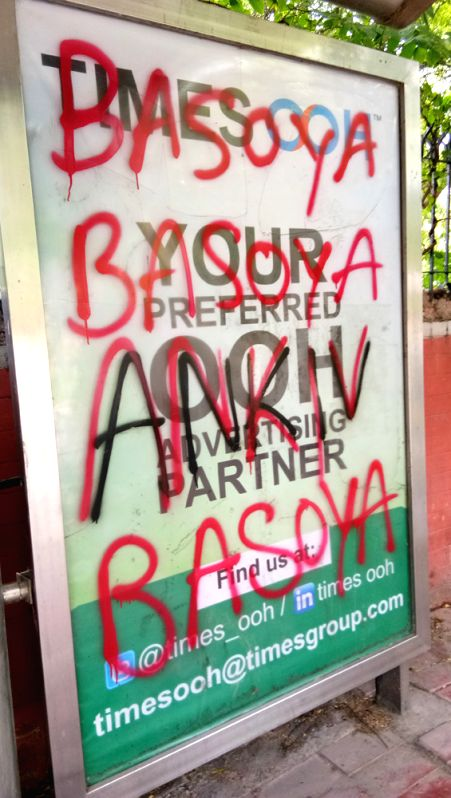Advertising space of Daulat Ram College bus stop covered with spray paint of an ABVP candidate's name.