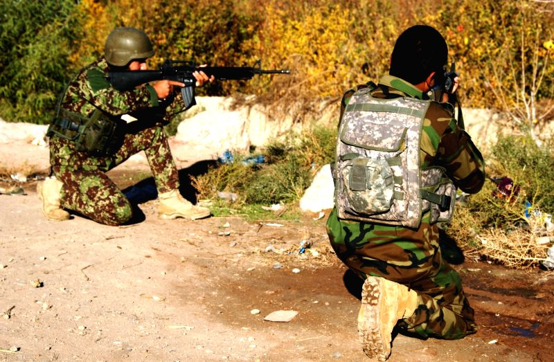 Afghan army soldiers take position during the attack in Arghandab district of southern Kandahar province, Afghanistan, Nov. 19, 2015. At least five militants and ...