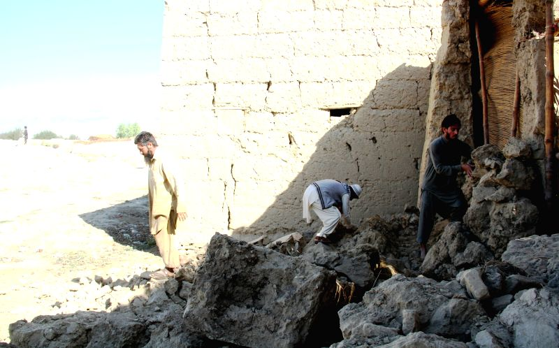 Afghan men work on the debris of a destroyed house in Nangarhar province, Afghanistan, Oct. 27, 2015. The death toll of Monday's earthquake in Afghanistan has ...