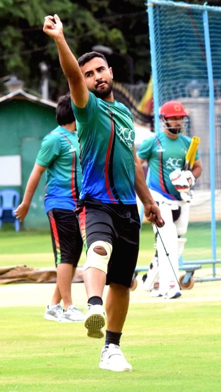 Afghan players during a practice session ahead of their maiden cricket test match against India in Bengaluru on Jan 10, 2018.