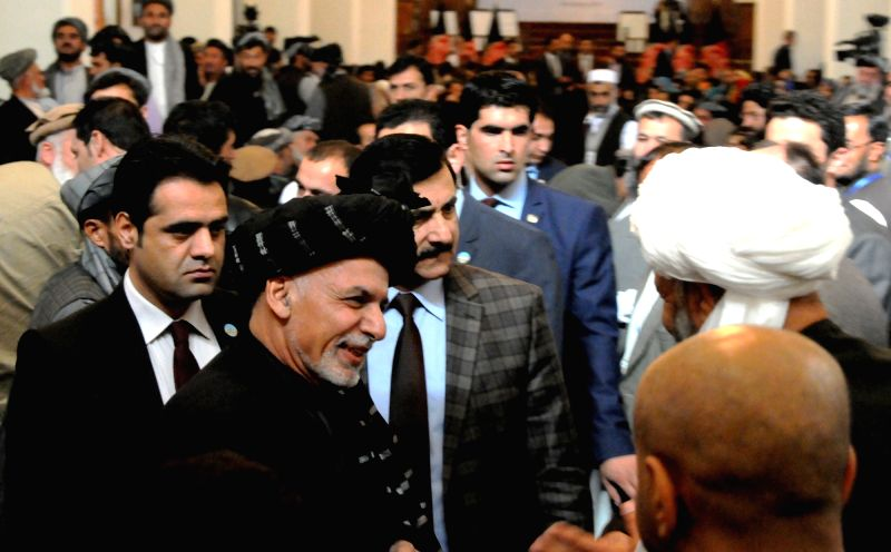 Afghan President Mohammad Ashraf Ghani (C) talks with villagers on the fifth National Community Development Councils Consultative Conference in Kabul, Afghanistan, ...