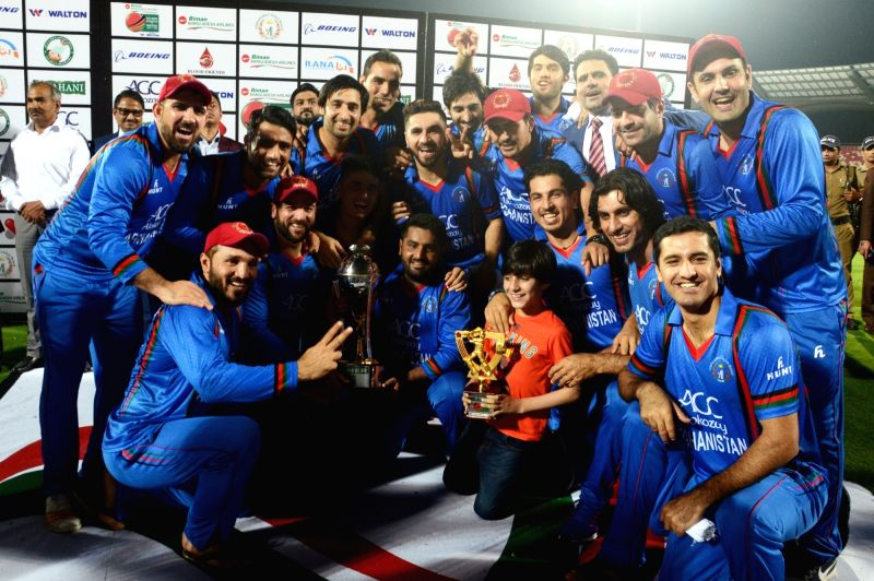 Afghanistan team with the winning trophy of T20 cricket match series between Bangladesh and Afghanistan in Dehradun on June 7, 2018.
