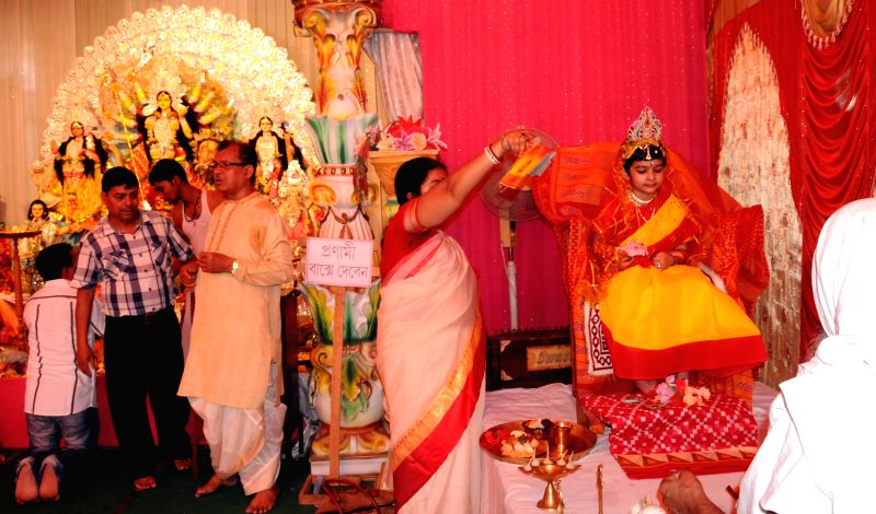A young girl being worshiped on Kumari Puja during the ongoing Basanti Puja in Agartala March 27, 2015.