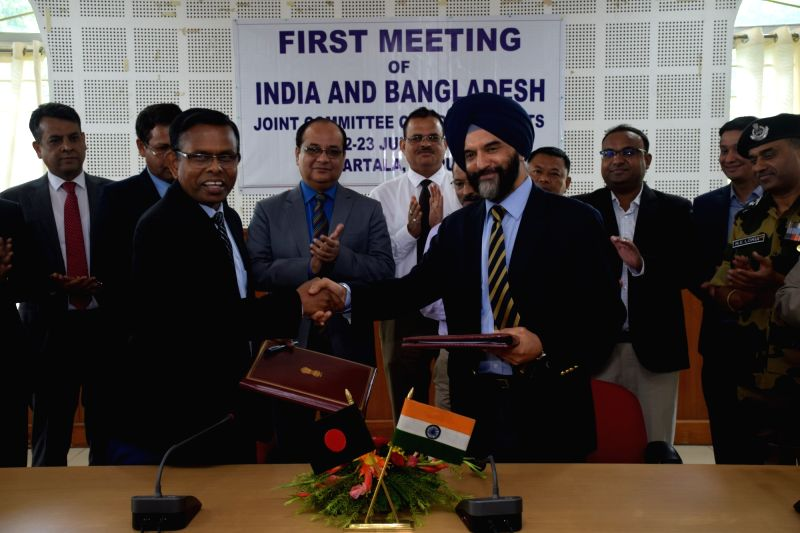 :Agartala: Agartala: Indian Commerce Ministry's Joint Secretary Bhupinder Singh Bhalla and Bangladesh Commerce Ministry's Additional secretary Shafiqul Islam during the official-level ...