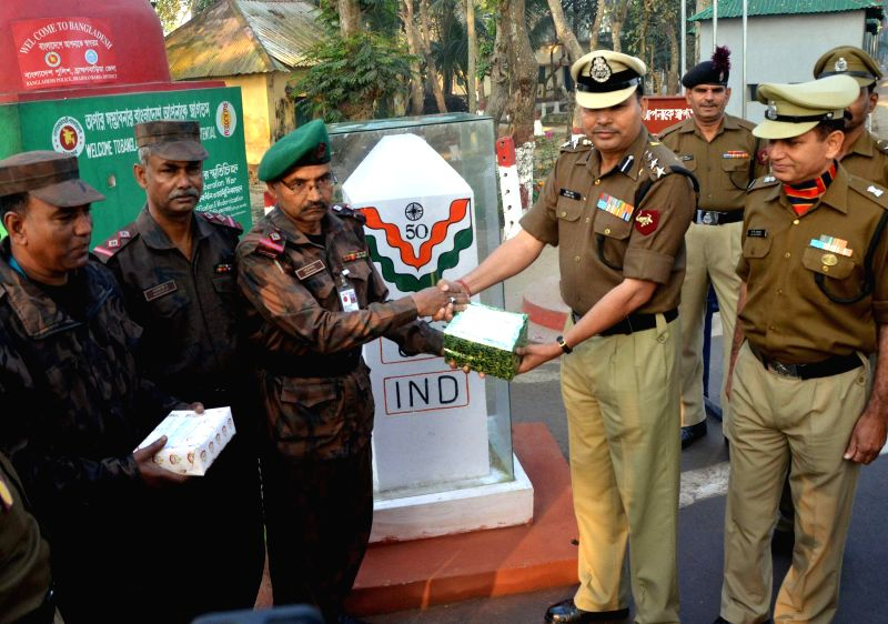 Border Security Force (BSF) officials being greeted by their Bangladeshi counterpart from Bangladesh Border Gaurd (BGB) on Indian Republic Day at Indo-Bangla Border in Agartala, on Jan 26, .