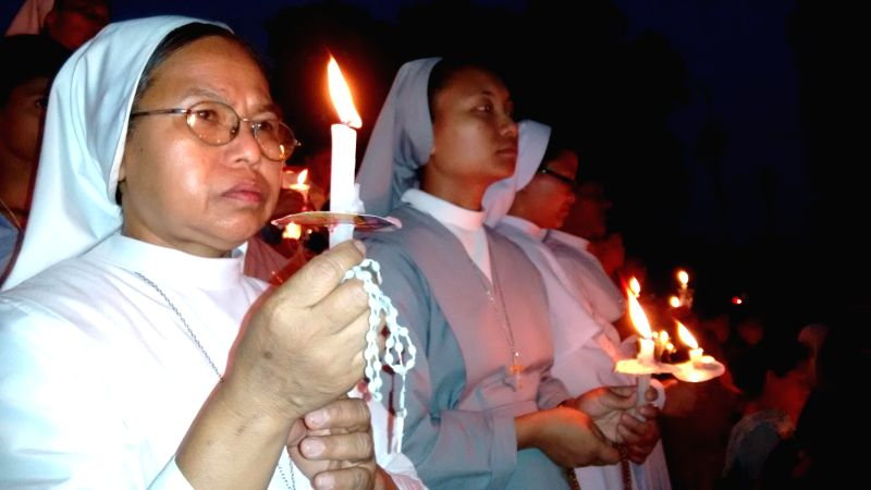 Nuns participate in a candlelight vigil to condemn the gang-rape of a nun in Ranaghat of West Bengal, in Agartala on March 20, 2015.
