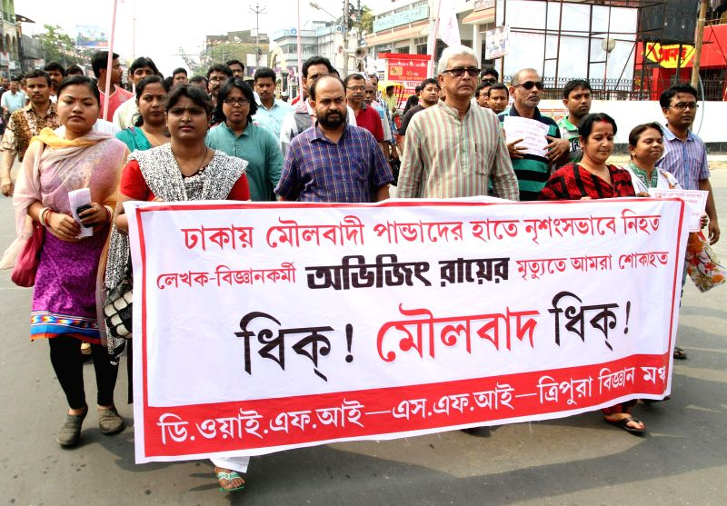 People participate in a rally to condemn the murder of Avijit Roy - a prominent American blogger of Bangladeshi origin, who was hacked to death in Dhaka; in Agartala, on March 1, 2015.