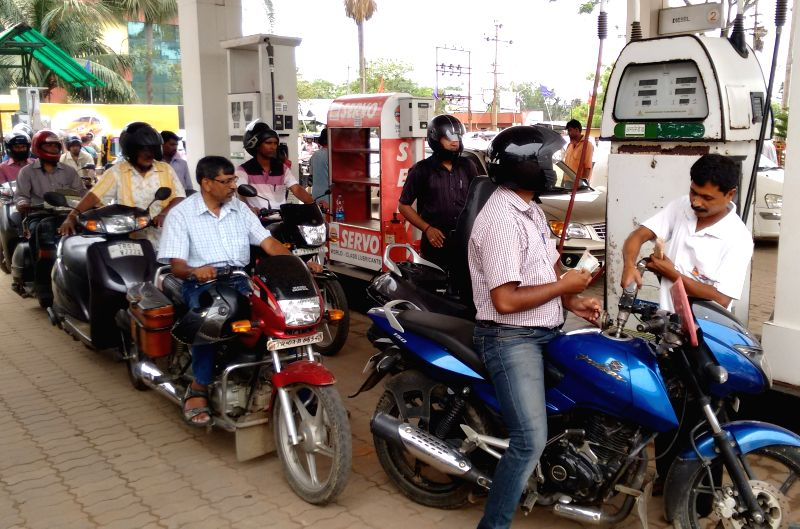 People queue up at an Agartala petrol station as Tripura is facing oil crisis on April 24, 2015.