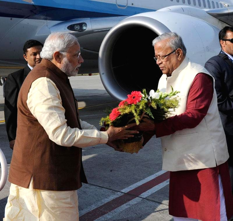Prime Minister Narendra Modi being received by the Tripura Governor P.B. Acharya on his arrival in Agartala, Tripura on Dec 1, 2014. - Narendra Modi