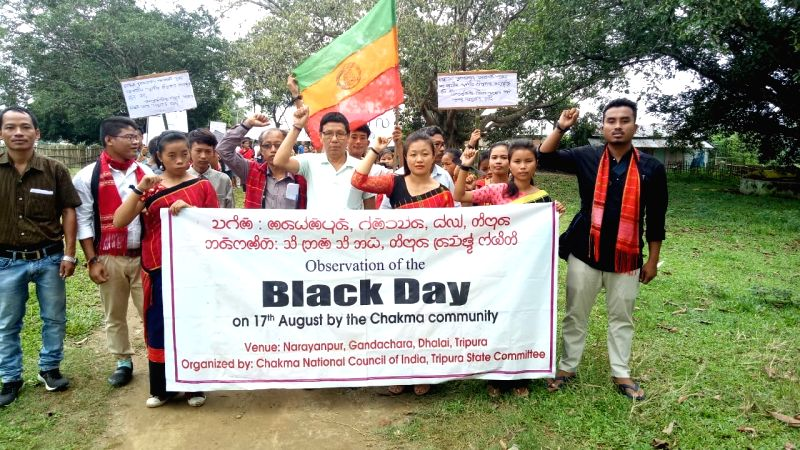 """Agartala: The Chakma tribals of northeast India and Chittagong Hill Tracts (CHT) of southeast Bangladesh participate in a rally as they observe """"Black Day"""" to protest the non-inclusion of non-Muslim dominated CHT in India during the partition in 1947"""