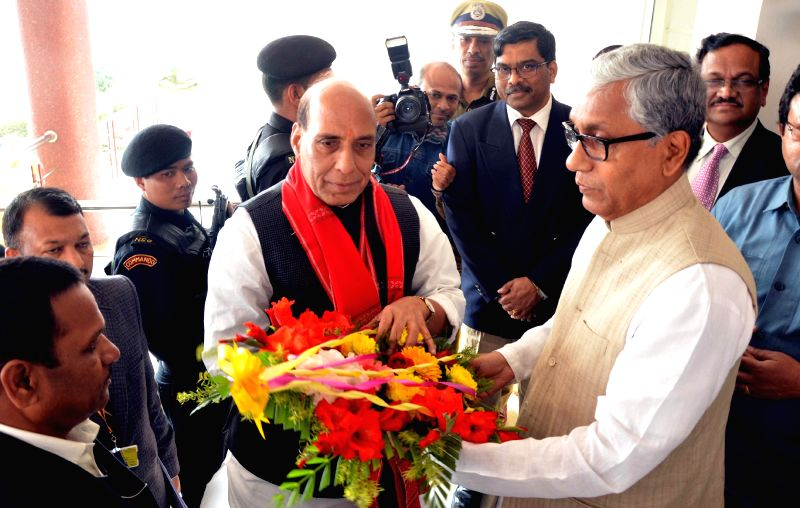 Union Home Minister Rajnath Singh being received by Tripura Chief Minister Manik Sarkar on his arrival at Agartala, Tripura on 14 Feb 2015.