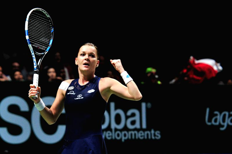 Agnieszka Radwanska of Poland celebrates after winning the semi-final match against Garbine Muguruza of Spain at WTA Finals in the Singapore Indoor Stadium, on ...