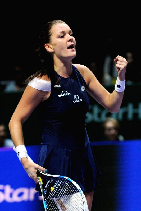 Agnieszka Radwanska of Poland reacts during the WTA Finals match against Simona Halep of Romania in Singapore, Oct. 29, 2015. Radwanska won 2-0. (Xinhua/Then Chih ...