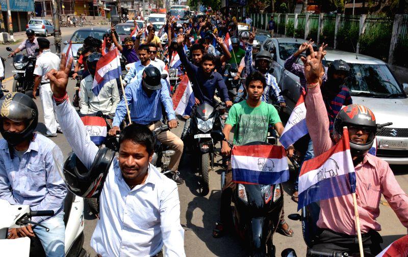 AGP workers campaign for party's candidate for 2014 Lok Sabha Election from Guwahati Lok Sabha seat Birendra Prashad Baishya in Guwahati on April 13, 2014.