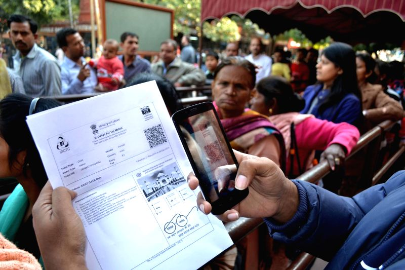 A person holding an e-ticket at Taj Mahal  in Agra on Dec 27, 2014. E-ticketing service facility for the Taj Mahal has been launched on a pilot basis to ensure safety of domestic and ...