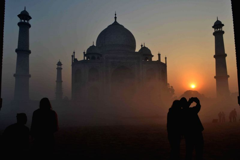A spectacular view of Taj Mahal with a thin blanket of fog around it during the sunrise in Agra, on Dec 9, 2014.