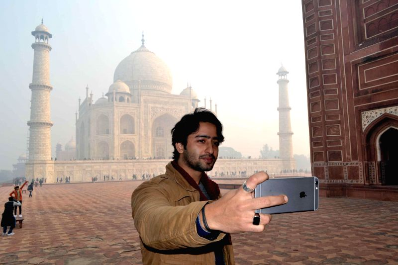 Actor Shaheer Sheikh takes a `selfie` (a self-portrait photograph) at the Taj Mahal in Agra, on Dec 28, 2014.