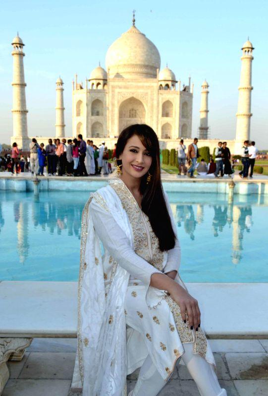 Actress Preeti Jhangiani poses for a photo at the Taj Mahal in Agra, on Dec 1, 2014.