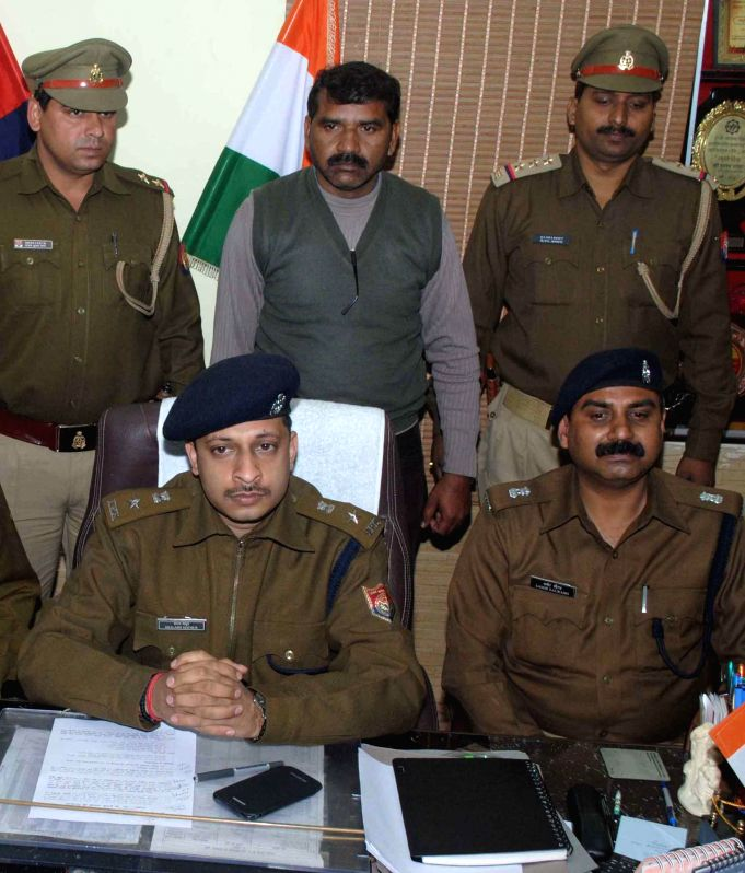 Agra SSP Shalabh Mathur and other police officers present Nand Kishore Valmiki the accused in the Agra religious conversion case before press in Agra on Dec 16, 2014.
