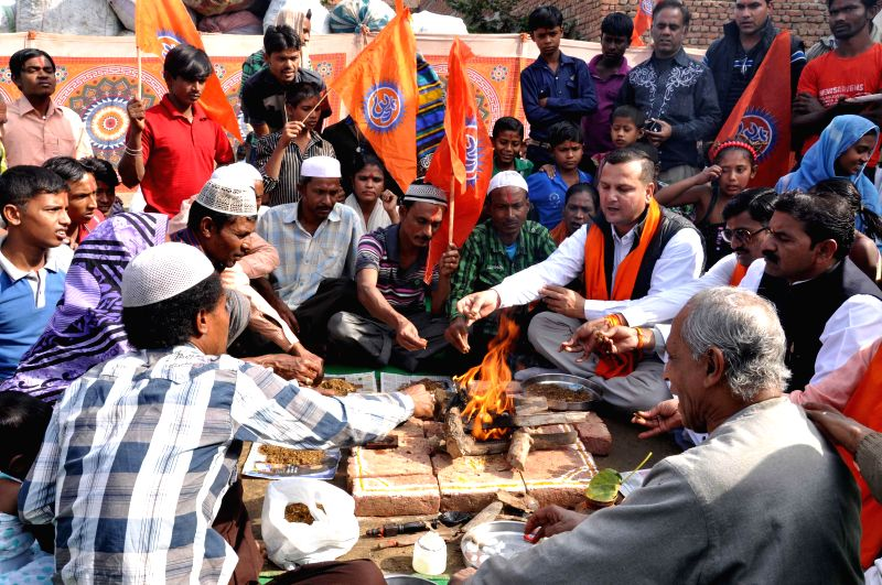 Bajrang Dal leaders perform rituals to convert Muslims into Hinduism in Agra.