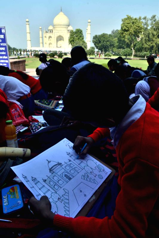 Children painting the Taj Mahal during a painting competition on the occasion of World Heritage Week in Agra on Nov. 20, 2014.