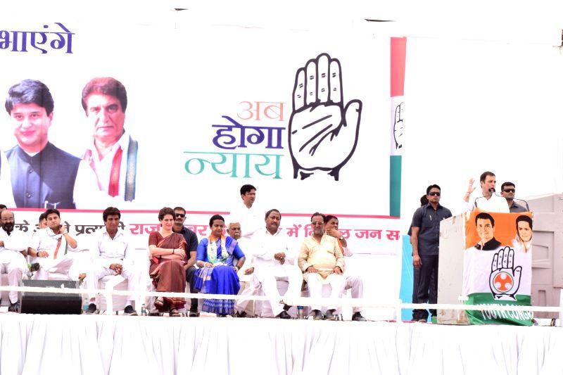 Agra: Congress President Rahul Gandhi addresses during a public rally at Bah in Uttar Pradesh's Agra, on April 15, 2019. Also seen Congress leaders Jyotiraditya Scindia, Raj Babbar and Priyanka Gandhi. (Photo: IANS)