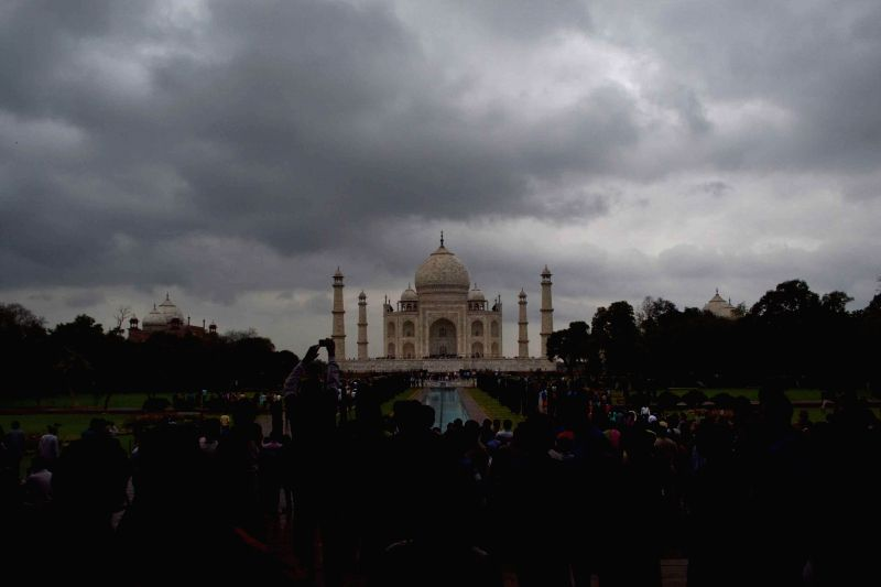 Dark clouds loom over the Taj Mahal in Agra, on March 1, 2015.