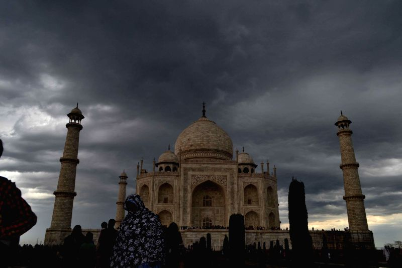 Dark clouds loom over the Taj Mahal in Agra, on March 15, 2015.