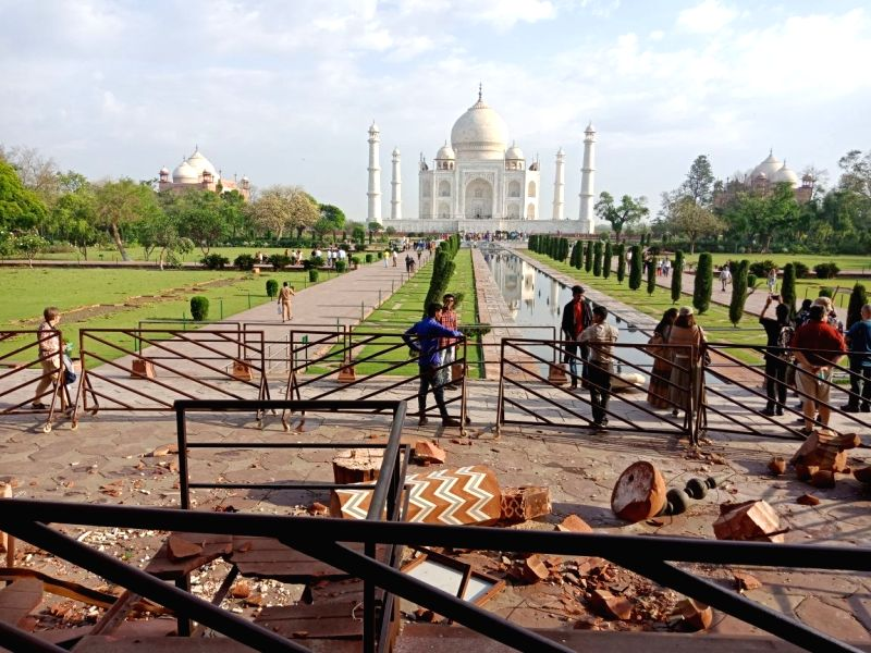 :Agra: Destruction caused by devastating storm and heavy showers at the Taj Mahal in Agra, on April 13, 2018. (Photo: IANS).