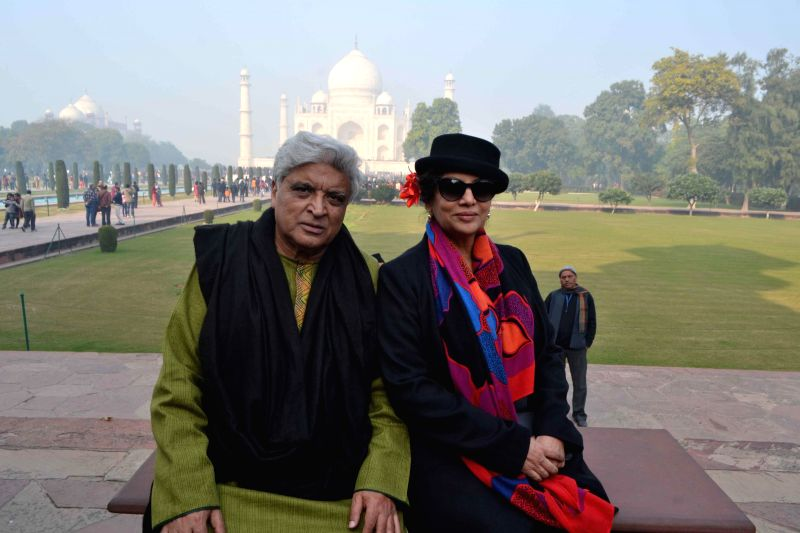 Indian poet, lyricist and scriptwriter Javed Akhtar and actress Shabana Azmi pose for a photograph during their visit to the Taj Mahal in Agra, on Dec 29, 2014.