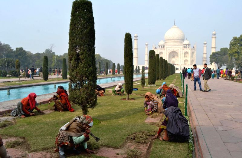 Labours busy landscaping the Taj Mahal gardens ahead of US President Barack Obama's expected visit on 27th January 2015, in Agra, on Jan 21, 2015.