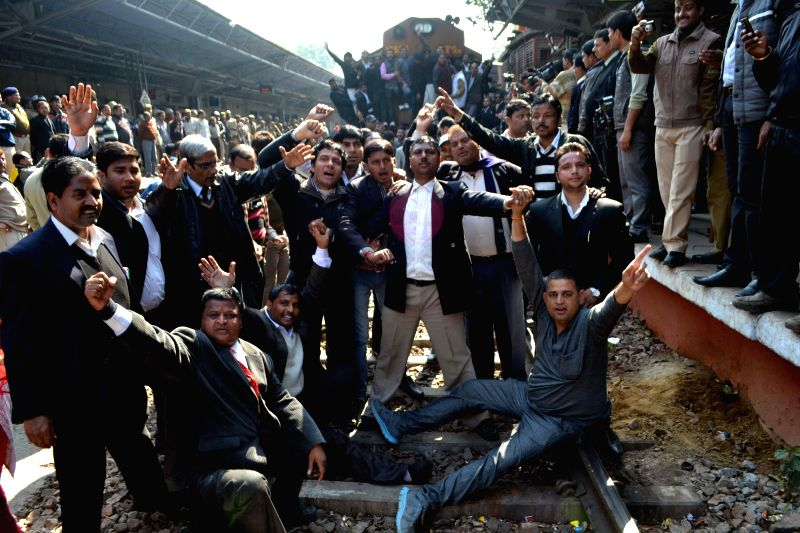 Lawyers of 17 district bars associations of west Uttar Pradesh disrupt railway services to undertake a `rail roko` campaign in Agra on Feb. 5, 2015. Lawyers` group are against the `action ...