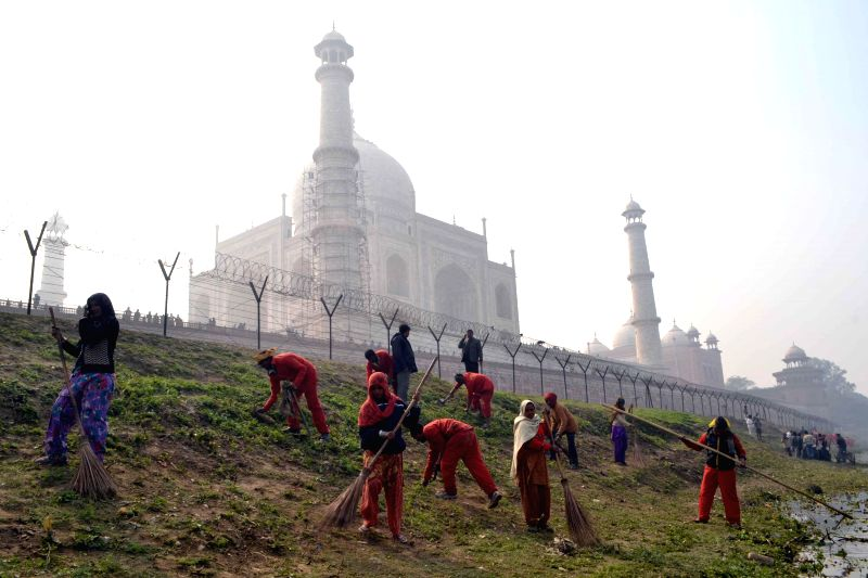 Municipality workers busy cleaning the surroundings of the Taj Mahal as US President Barack Obama is expected to visit Agra on 27th January 2015. (Photo : IANS)