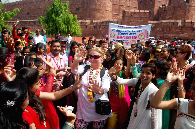People celebrate on the occasion of World Heritage Day in Agra, on April 18, 2015.
