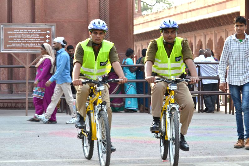 Policemen on bicycle patrol inside Taj Mahal in Agra, on March 14, 2015.