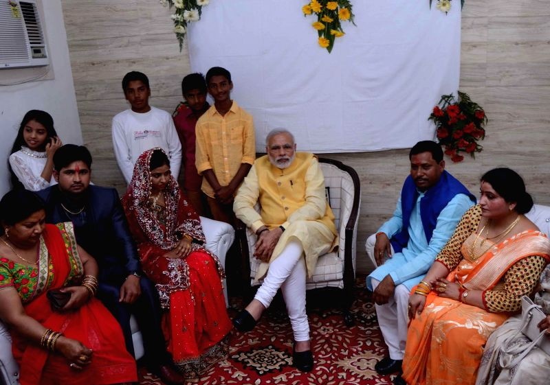 Prime Minister Narendra Modi blessed MoS for HRD Ram Shankar Katheria`s adopted daughter Uma and her would be husband Kamal at the residence of Ram Shankar Katheria in Agra, on Feb 21, 2015. - Narendra Modi