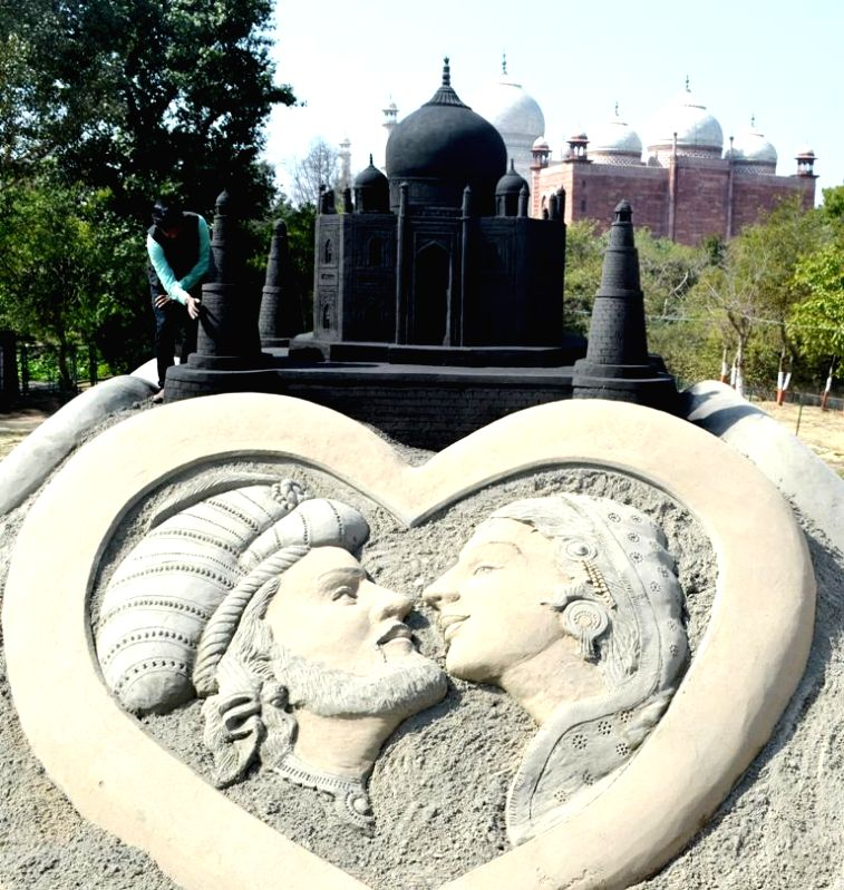 Renowned Indian sand artist Sudarsan Pattnaik's `Black Taj` - black replica of the Taj Mahal at the Taj Nature Walk in Agra. The 15-feet structure is adorned with the sculptures of Mughal ...
