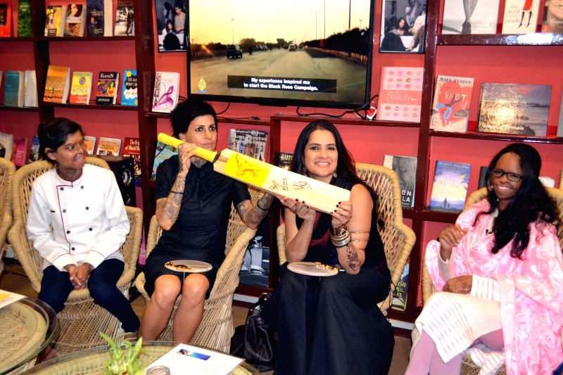 Singer Sona Mohapatra and celebrity hairstylist Sapna Bhavnani at the auction of a cricket bat signed by Indian cricket captain MS Dhoni at the Sheroes Hangout in Agra, on Dec 10, 2014. - MS Dhoni