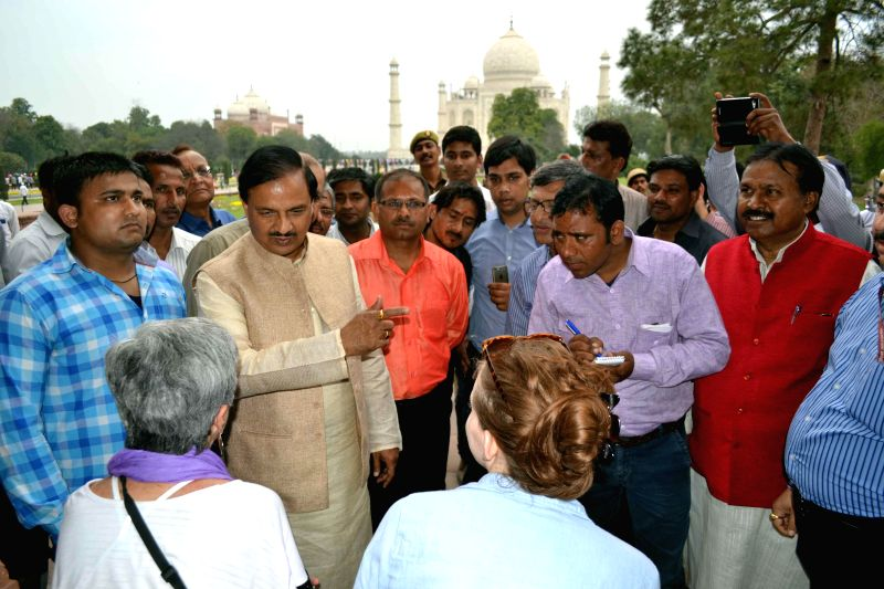 The Union Minister of State (Independent charge), Culture and Tourism Mahesh Chand Sharma interacts with the foreign tourists during his visit to the Taj Mahal in Agra on Feb 24, 2015. - Mahesh Chand Sharma