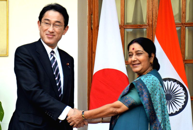 Visiting Japanese Foreign Minister Fumio Kishida (L) shakes hands with External Affairs Minister Sushma Swaraj at Hyderabad House in New Delhi, Jan. 17, 2015.