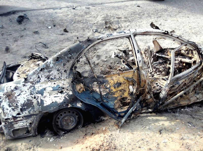 AHMAD WAL, May 22, 2016 - Photo taken with mobile phone on May 22, 2016 shows a destroyed vehicle believed to be hit by a U.S. drone strike in Ahmad Wal, a small town in Pakistan's southwest ...
