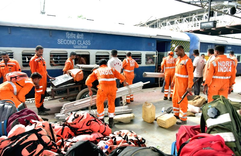 Ahmedabad: A team of NDRF personnel arrives at the Ahmedabad Railway Station as they prepare to leave for Saurashtra by road with emergency and rescue material to carry out evacuation drive in the wake of Cyclone Vayu, on June 12, 2019. Cyclone Vayu