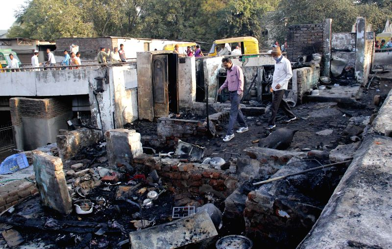 A view of the hutment near Kalupur bridge of Ahmedabad that was gutted in a fire that broke out in the wee hours of Feb 25, 2015. Five people were killed and four others injured in the ...