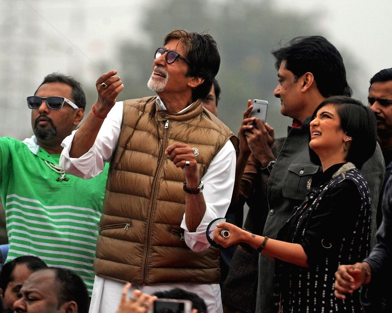 Actor Amitabh Bachchan, Akshara Haasan and Dhanush fly kites during promotion of their upcoming film  `Shamitabh` in Ahmedabad, on Jan 14, 2015.