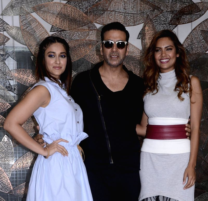 "Ahmedabad: Actors Akshay Kumar, Ileana D'Cruz and Esha Gupta during the promotion of their upcoming film ""Rustom"" in Ahmedabad on Aug 3, 2016. - Akshay Kumar, Ileana D'Cruz and Esha Gupta"
