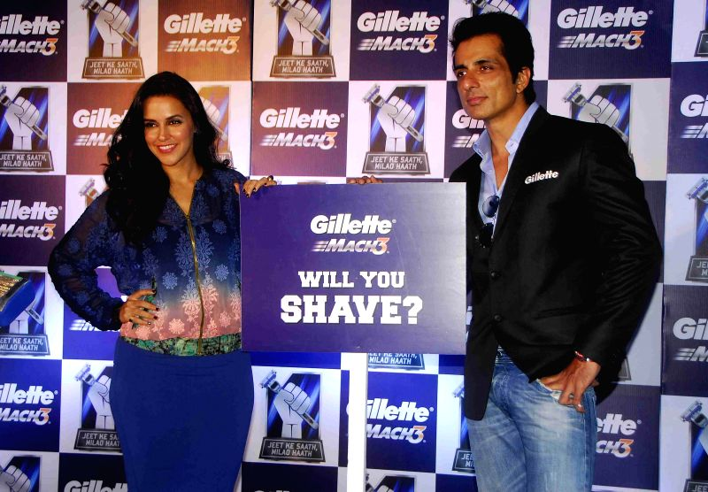Actors Neha Dhupia and Sonu Sood during a promotional programme in Ahmedabad, on Dec 17, 2014.