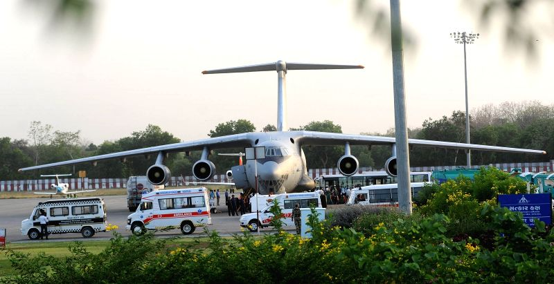 An Indian Air Force aircraft carrying the bodies of the victims of Nepal bus accident arrives at Ahmedabad airport on April 23, 2015.  17 Indian pilgrims from Gujarat were killed when ...