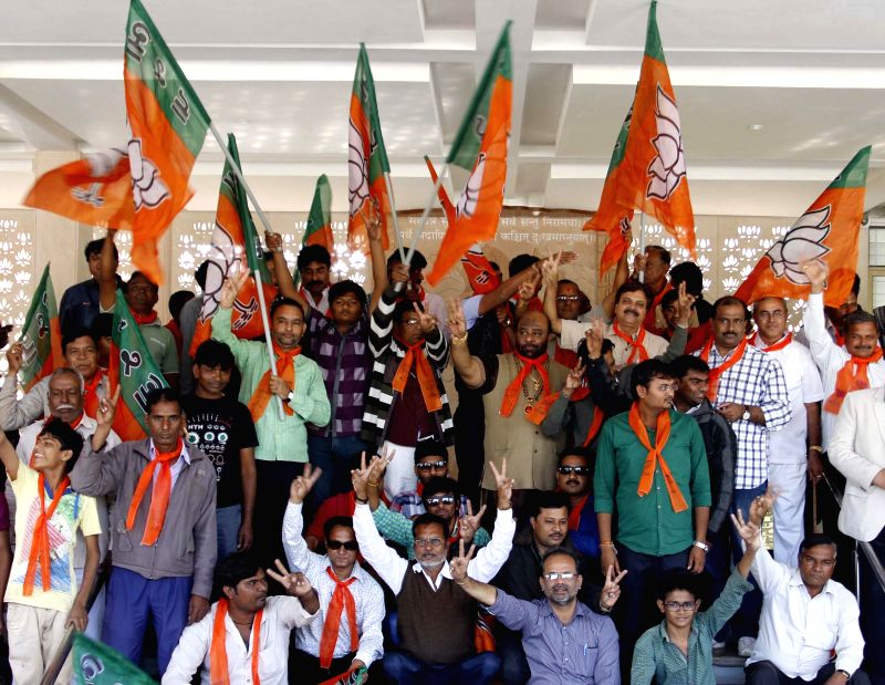 BJP workers celebrate party's performance in Jharkhand and Jammu and Kashmir assembly polls in Ahmedabad, on Dec 23, 2014.